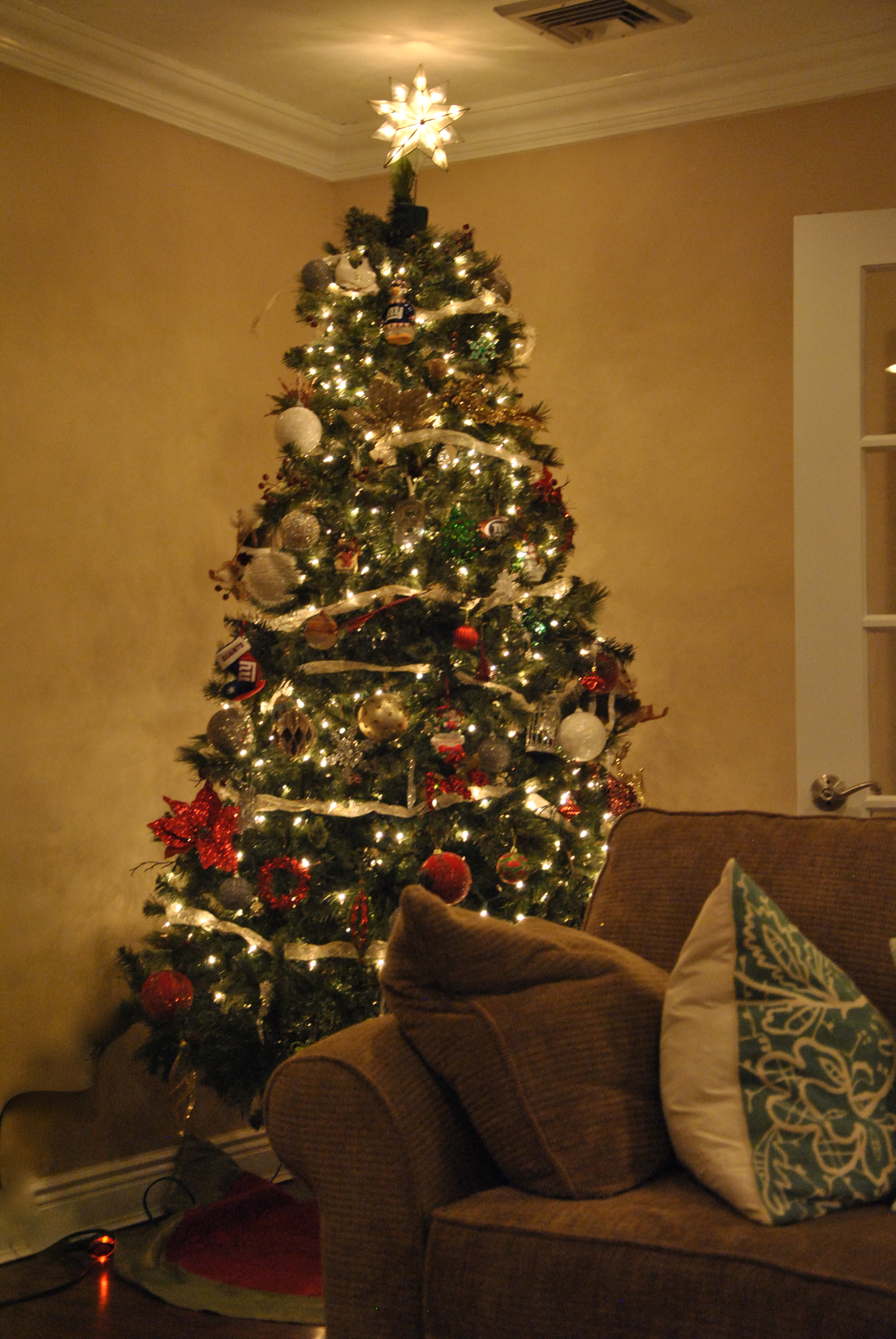 Beach themed christmas ornaments - Our Beach Themed Tree In The Sunroom Is A Real Tree Complete With A Flamingo Tree Skirt And Starfish Tree Topper On It You Will Find Ornaments From Some